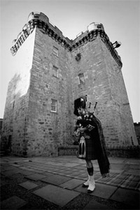 Lone piper at Lennox Town Castle